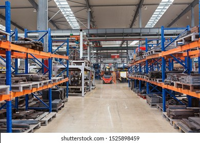 Large hangar warehouse of industrial and logistics companies. Long shelves with a variety of boxes. industry space and hardware box for delivery, business logistic distribution storage cargo concept.