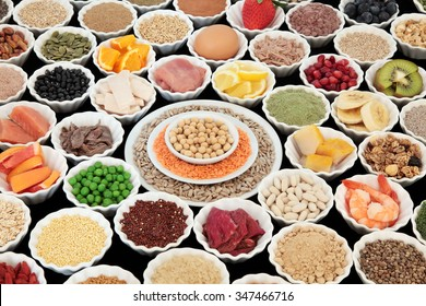 Large health and body building high protein super food of meat, fish, dairy, pulses, cereals, grains, seeds, supplement powders, fruit, vegetable  selection. Selective focus.