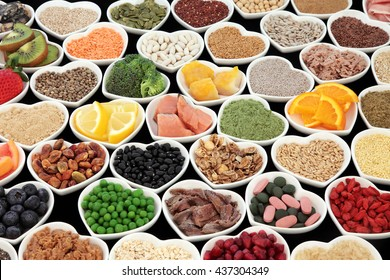 Large health and body building protein super food with high nutritional values including meat, fish, pulses, cereals, grains, seeds, supplement powders, fruit and vegetables.