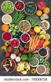 Large health food collection with fruit, fish, vegetables with spices and herbs also used in natural herbal medicine. Superfood concept with foods high anthocyanins, fiber, antioxidants and vitamins.