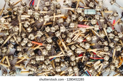Large heap of old transistors on white background