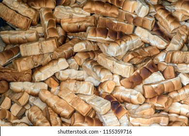 Large heap of pastries. Old pastry on the pile. Bread ready for feeding to fish, Thailand.