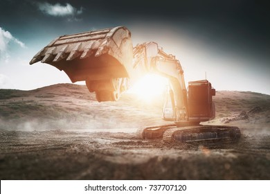 Large heavy duty digger or backhoe with bright sun flare at sunrise in the centre of an earth works excavation site with wafting morning mist in an industrial concept. 3d rendering