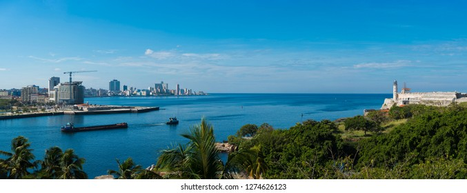 Large high resolution panoramic view of entrance to the Havana Harbor, with the Punta and Morro fortresses at both sides.