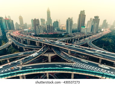 Large highway junction in Shanghai, China with traffic. Famous landmark of Shanghai in the evening.
