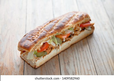 Large hoagie sandwich with veggies and meat