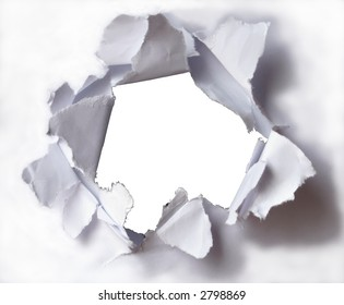 Large hole in the white paper (background).