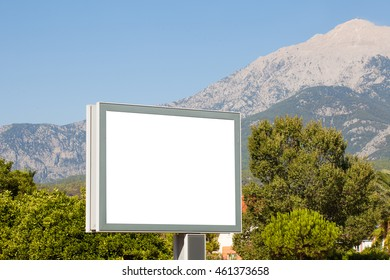 Large horizontal Billboard for advertising on a background of mountains . To insert .