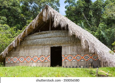 Large house covered with sape grass, Indigenous tribe village near Manaus, Amazonas State, Brazil 2015