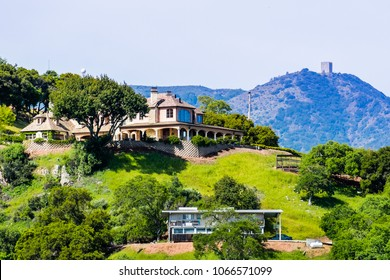 Large house in the hills of south San Francisco bay area, Mount Umunhum in the background; San Jose, Santa Clara county, California