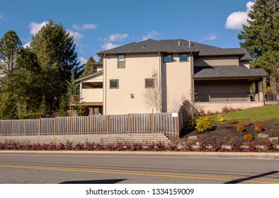 Large house surrounded with trees in a suburbs Oregon.