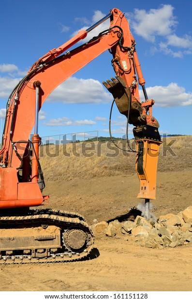 Large Hydraulic Rock Breaker Ram Hammer Stock Photo (Edit