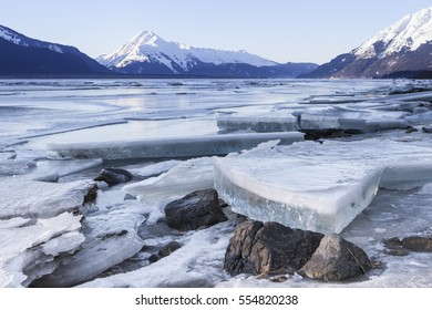 Large ice chunks on the beach of the Chilkat river estuary near Haines Alaska as the tide goes out.