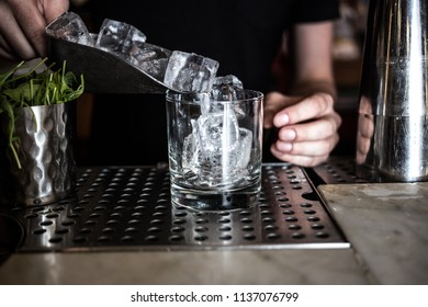 Large ice cubes in a glass for a cocktail