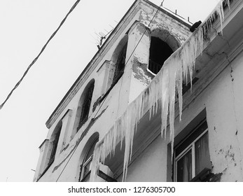 Large ice floes hanging from roofs. Dangerous situation.