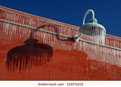 Large icicles hanging from light fixture after ice storm