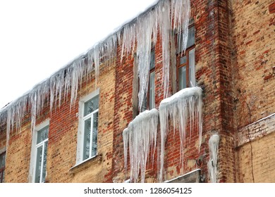 Large icicles on the facade of the building