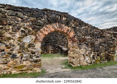 A large and impressive doorway survives among old stone walls at Spanish Mission San Francisco de la Espada in San Antonio, Texas.