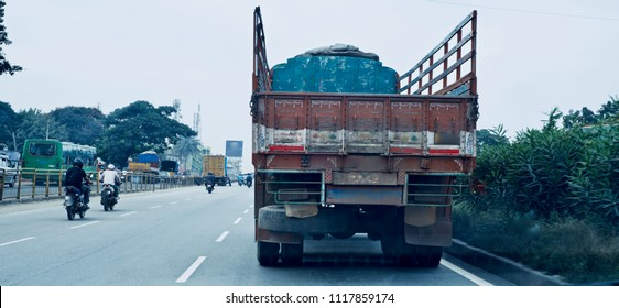 A large Indian truck is running on the Bangalore city highway isolated unique photo