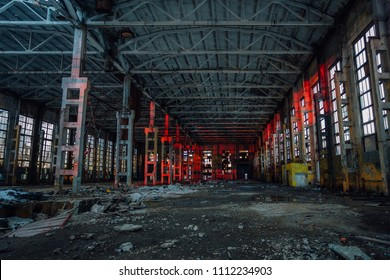 Large industrial hall illuminated by red lights. Abandoned Voronezh excavator plant.