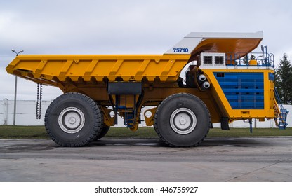 Large Industrial Mining Dump Truck BelAZ Background. Zodzina, Belarus - March 9, 2016: Yellow colored worlds biggest Haul truck BelAZ 75710 by Belarusian manufacturer BelAZ.
