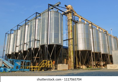 Large, industrial pellet and grain bins used for containing livestock and fish feed for commercial bulk sale.