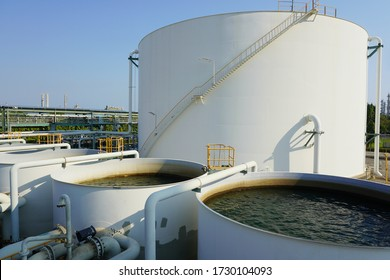 Large industrial tanks or spherical tanks for filter and wastewater treatment system of petrochemical plant, oil and gas or water in refinery or power plant for industrial plant on blue sky background