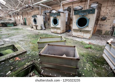 Large industrial washing machines in the laundry at an abandoned and derelict lunatic asylum/hospital (now demolished), Cane Hill, Coulsdon, Surrey, England, UK