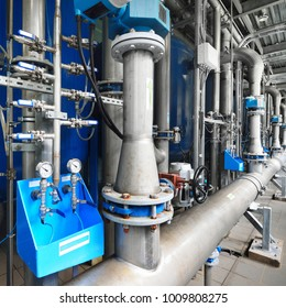 Large industrial water treatment and boiler room. Pressure vessels, piping, armature, butterlfy valves