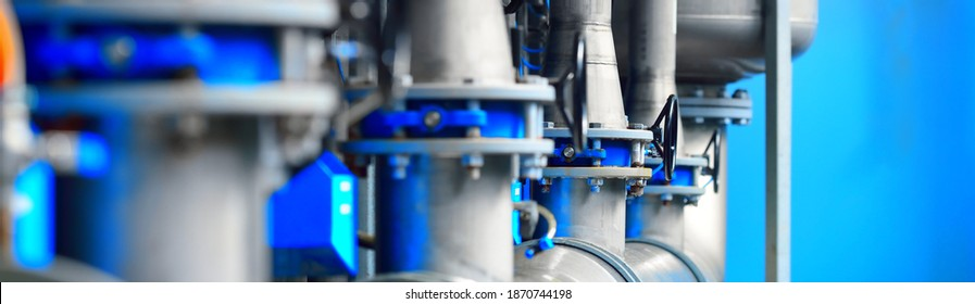 Large industrial water treatment and boiler room. Piping, flanges, butterlfy valves, rusty and corroded bolts. Industry, technology, special equipment, biotechnology, chemistry, heating, work safety