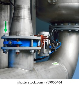 Large industrial water treatment and boiler room. Piping, valves, flanges
