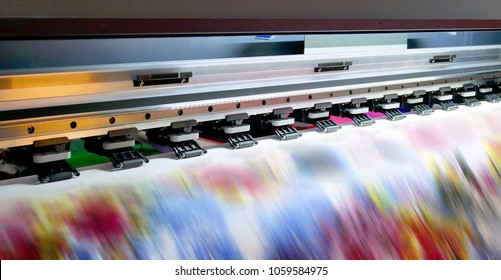 Large inkjet printing machine during production on vinyl banner.