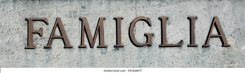large inscription with word FAMIGLIA that means FAMILY in Italian with uppercase characters