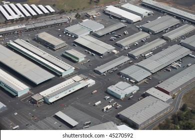 Large integrated warehouse and logistics distribution hub for loading and unloading of trucks.