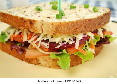 Large jumbo garden salad sandwich with beetroot and cheese ready to serve.