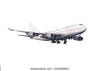 A large jumbo size airplane with four engines on the wings and landing gear with many wheels  and window isolated on white