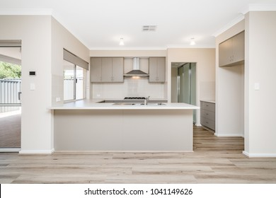 Large kitchen interior with brown coloured cabinetry in modern Australian home. PERTH, WESTERN AUSTRALIA. Photographed: February, 2018.