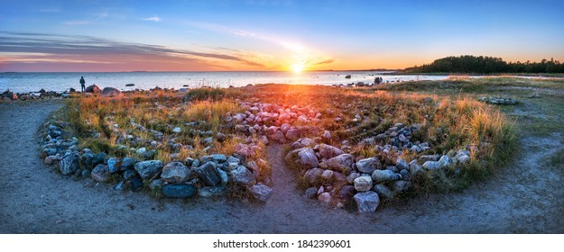 A large labyrinth of stones on the shores of the White Sea on the Solovetsky Islands at the Cape of Labyrinths in the light of the setting autumn sun