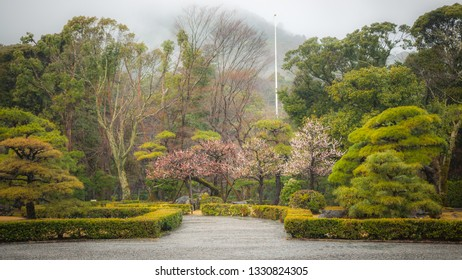Large landscaped gardens with lush greenery seen in the shrine grounds of the Ise Grand Shrine, which is Japan's most sacred Shinto shrine located in the city of Ise, Mie Prefecture of Japan.