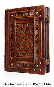 """Large leather bound book with Latin text """"Memento Mori"""" engraved several times as a frame - stand up view. English translation of the Latin text is: """"Remember that you have to die"""""""