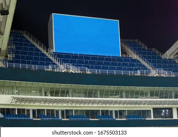 Large LED screen in stadium with empty seats. Scoreboard for sport matches