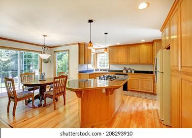 Large Light Golden Wood Kitchen With Same Color Of Hardwood.