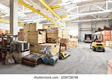 Large and light warehouse, cargo storage in wooden boxes
