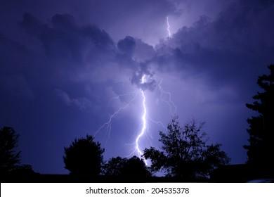 Large lightning bolt at night.