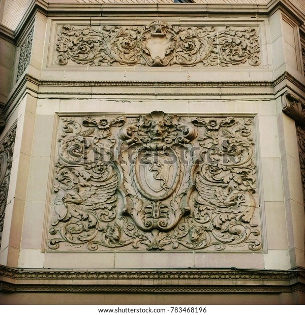 A large lion roaring architecture crest above a door, sculpture from stone beautifully carved