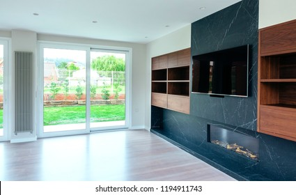 Large living room empty with fireplace and TV