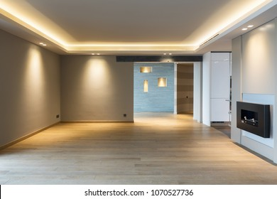 Large living room in modern apartment with led to the ceiling. Nobody inside
