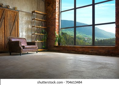 Large Loft Interior With Mountains In The Window