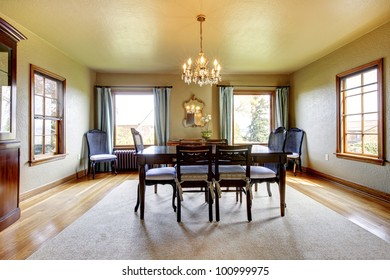 Large luxury elegant old dining room with four windows.