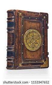 Large luxury leather - wooden book with a gilded transmutation circle in center of the front cover, attributed to a German alchemist from the 17th century. It stay on the table, angled on the left